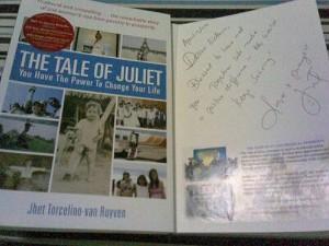 Juliet signs her book for Ka Edong