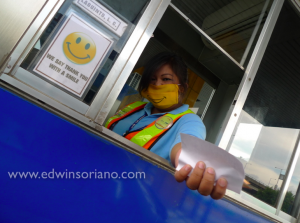 Say Thank You with a Smile! - Smiley Masks at the SLEX toll gates