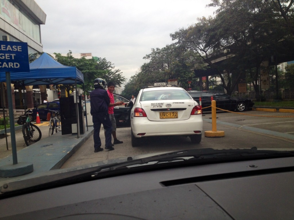"Taxi driver comes down to meet his Good Samaritan. I think the driver even tried to ""re-pay"" the Good Samaritan ."